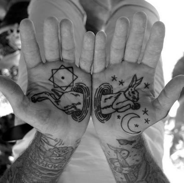 inner hand rabbit maic tattoo