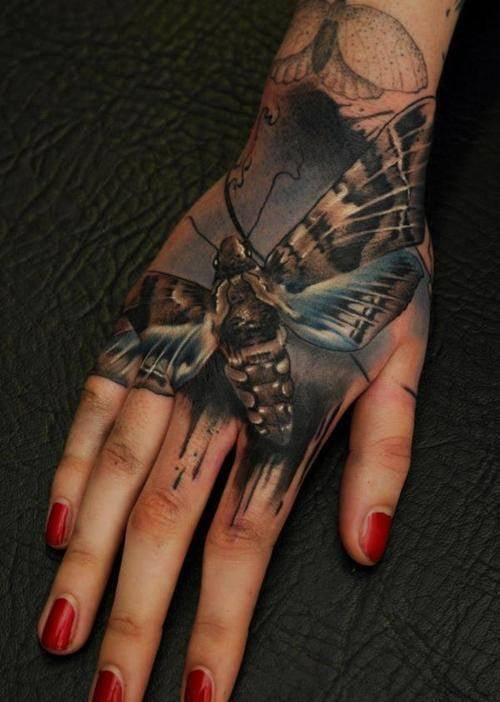 Florian Karg moth butterfly hand tattoo