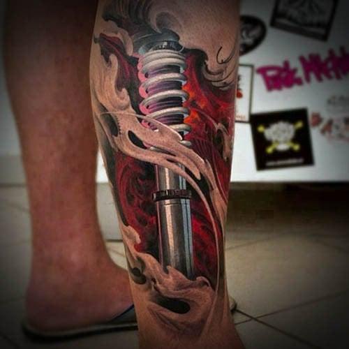 men leg tattoo