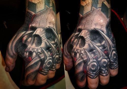 Javier Obregon  skull hand tattoo