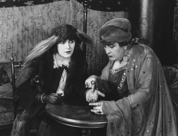 Classic movie images of fortune tellers.