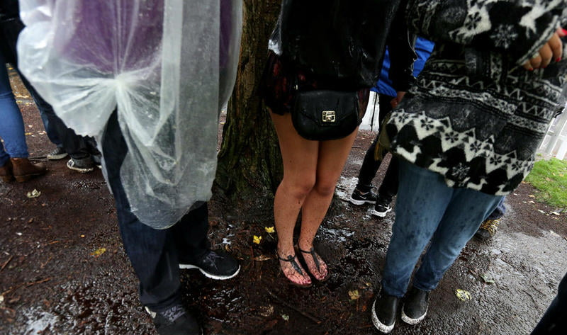 Fans stand in the rain at Bumbershoot 2015