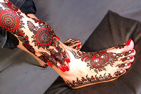 Colorful henna designs of the foot and leg