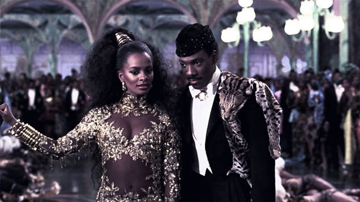 Vanessa Bell Calloway is a vision with her gold belly baring gown from Coming To America