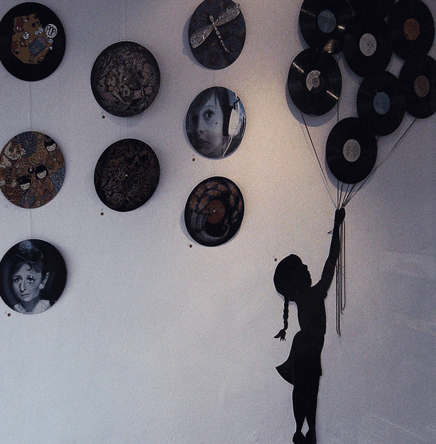 Creative dorm decor idea- Hang old records instead of posters!