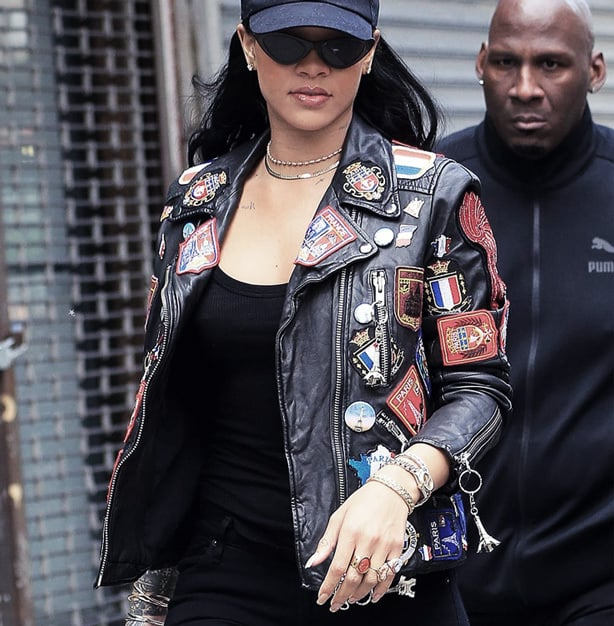 Rihanna uses patches on a leather jacket to stand out in a crowd.