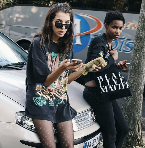 A modern twist on 90s grunge was a huge street style favorite at Paris Fashion Week