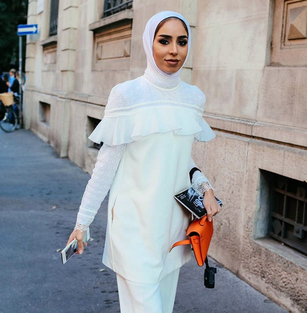 Go with an all white outfit like the street fashionistas at Milan Fashion Week