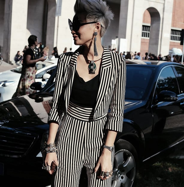 Street Style Milan Fashion Week - Esther Quek rocking a full outfit of stripes.