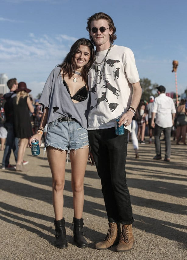 A picture of a couple wearing urban fashion, ripped shorts and combat boots