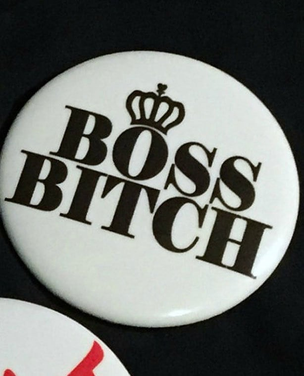 "Feminist badge accessory with the words ""boss bitch"" in bold"