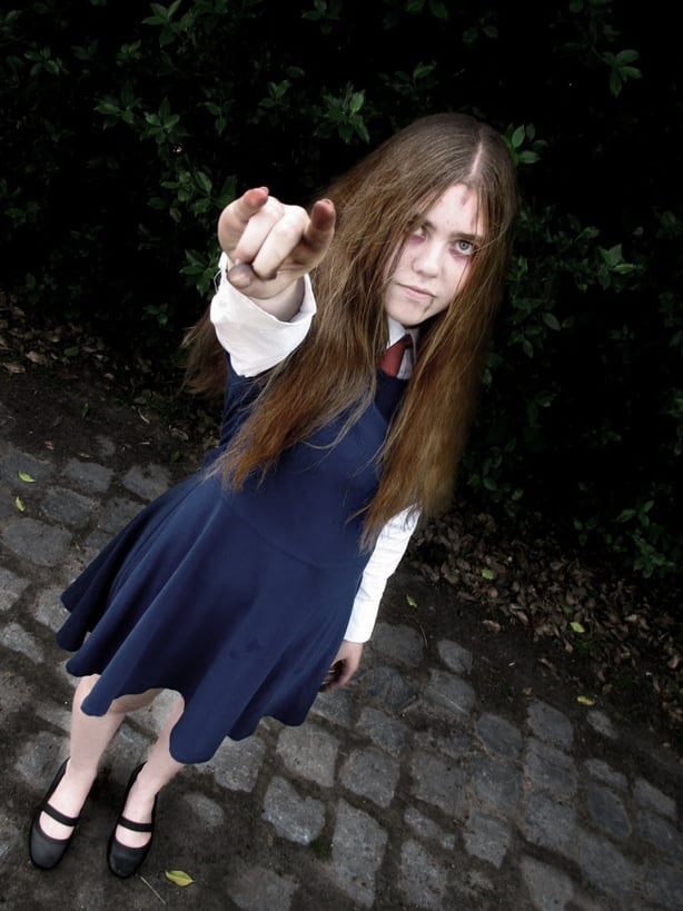 A girl dressed as Allessa from Silent Hill, wearing a blue dress and gothic makeup