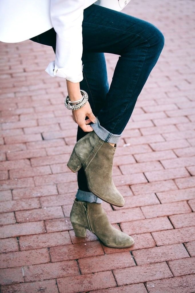 A close up image of some mid-heel ankle boots