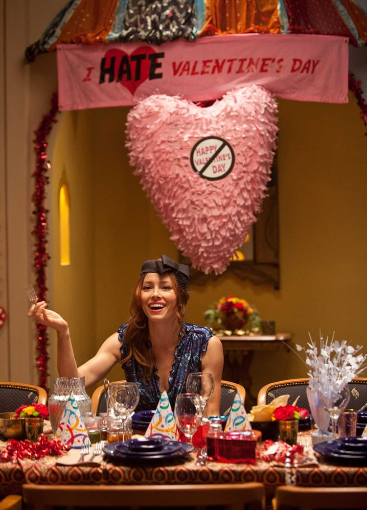 A woman celebrating an unvalentine's day or antivalentine's day, with antivalentine's decor in the background