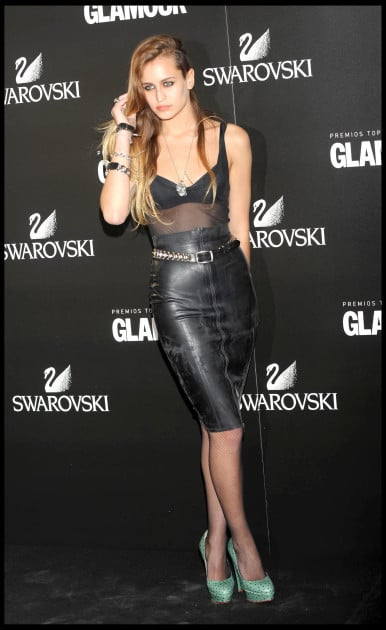 Model Alice Dellal wears a leather pencil skirt and mesh top, accented with punk jewelry