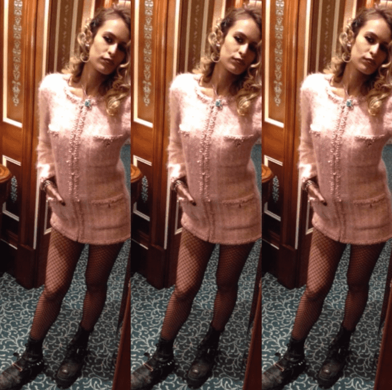 Alice Dellal mixes feminine fashion with punk accessories by wearing a pink Chanel dress and grungy combat boots