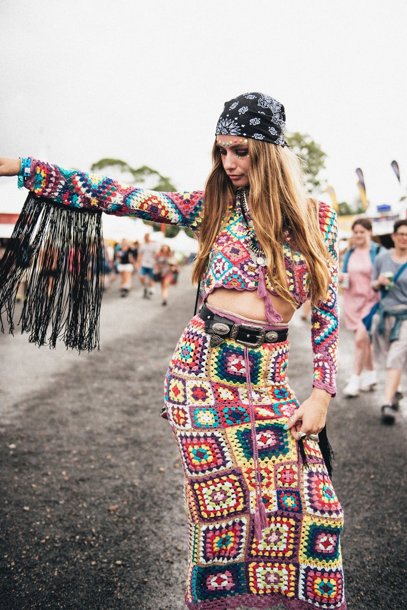 A hippie chick in a bandana wearing a matching two-piece crochet crop top and skirt