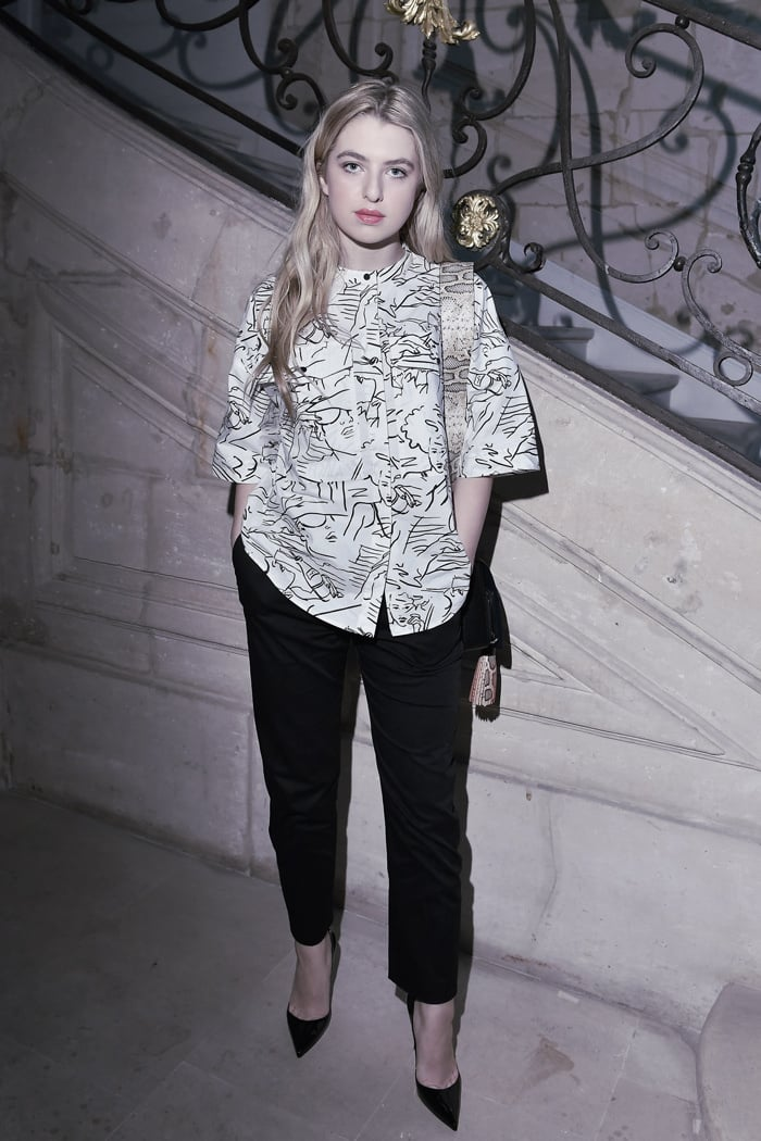 Anaïs Gallagher wears an oversize boyfriend shirt and cropped trousers
