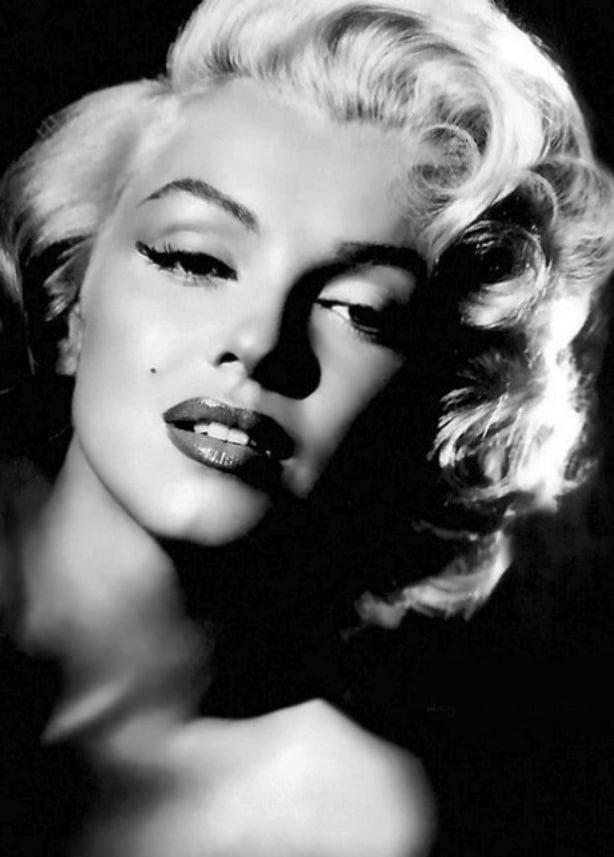 A Visual History of Cat Eye Makeup: Marilyn Monroe wears a subtle flick of eyeliner