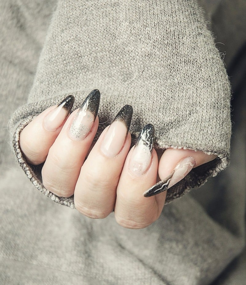 Tips for acrylic nail extensions: Black tips on stiletto nails