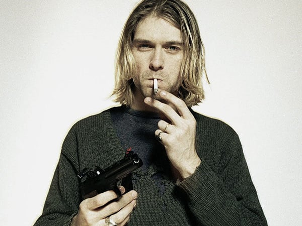 Oversized worn sweaters a re a staple of grunge fashion, as demonstrated by Kurt Cobain