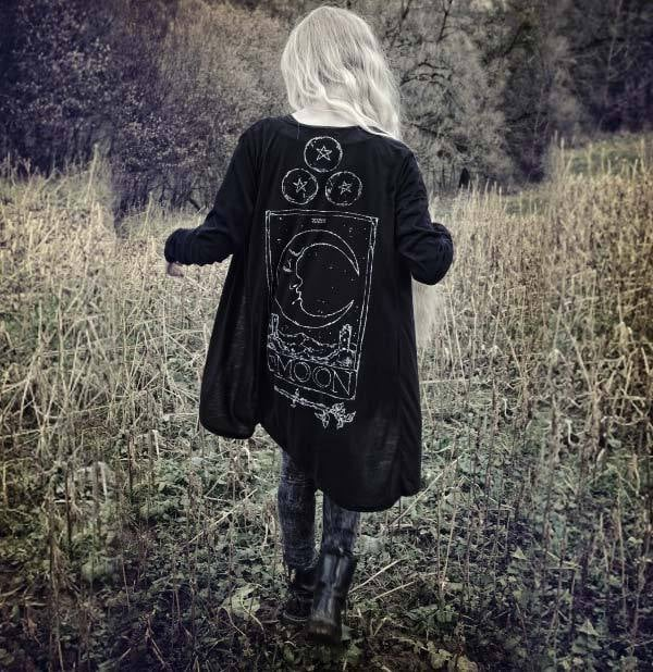 Witchy gothic outfit with occult themed cardigan