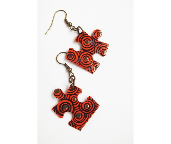handpainted_puzzle_piece_earrings_orange_swirly_pattern_upcycled_earrings_2.jpg