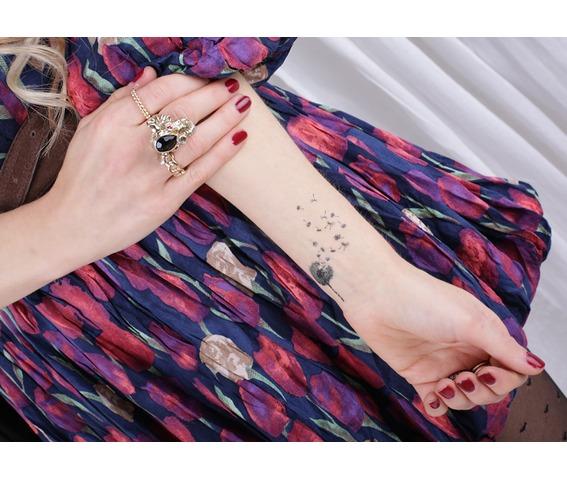 dandelion_tattoo_50aa43e1e087c36dea991c4f.jpg