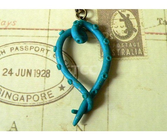 turquoise_tentacle_heart_necklace_with_24_ct_gold_flecks_necklaces_2.jpg