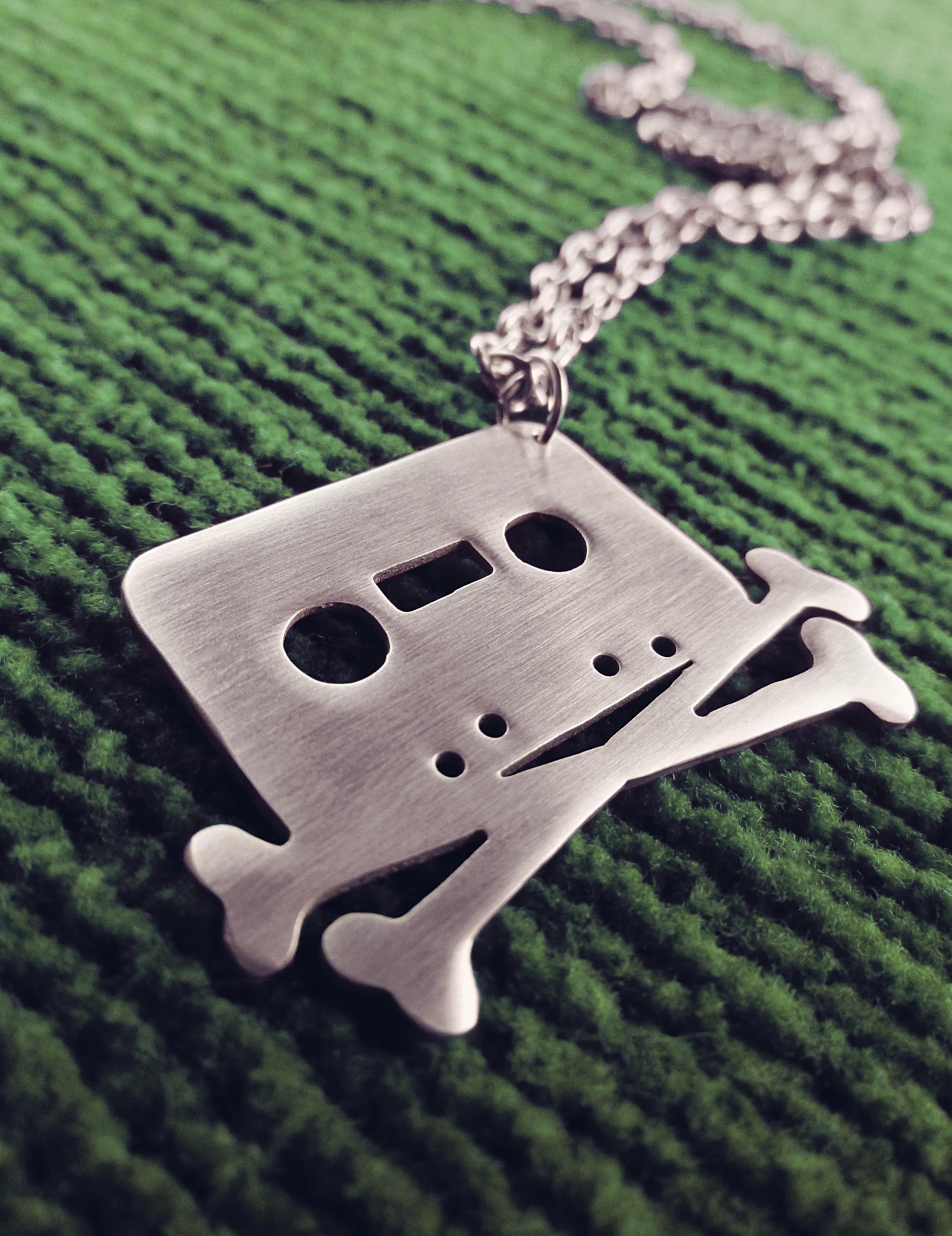 tape_and_crossbones_necklace_the_pirate_bay_cassette_necklaces_3.jpg