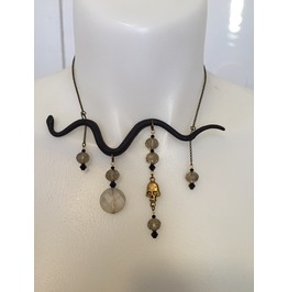 Snake Necklace With Dangling Brass Skull Charm And Crystal Beads