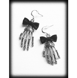 Silver Skeleton Hand Earrings With Black Bows