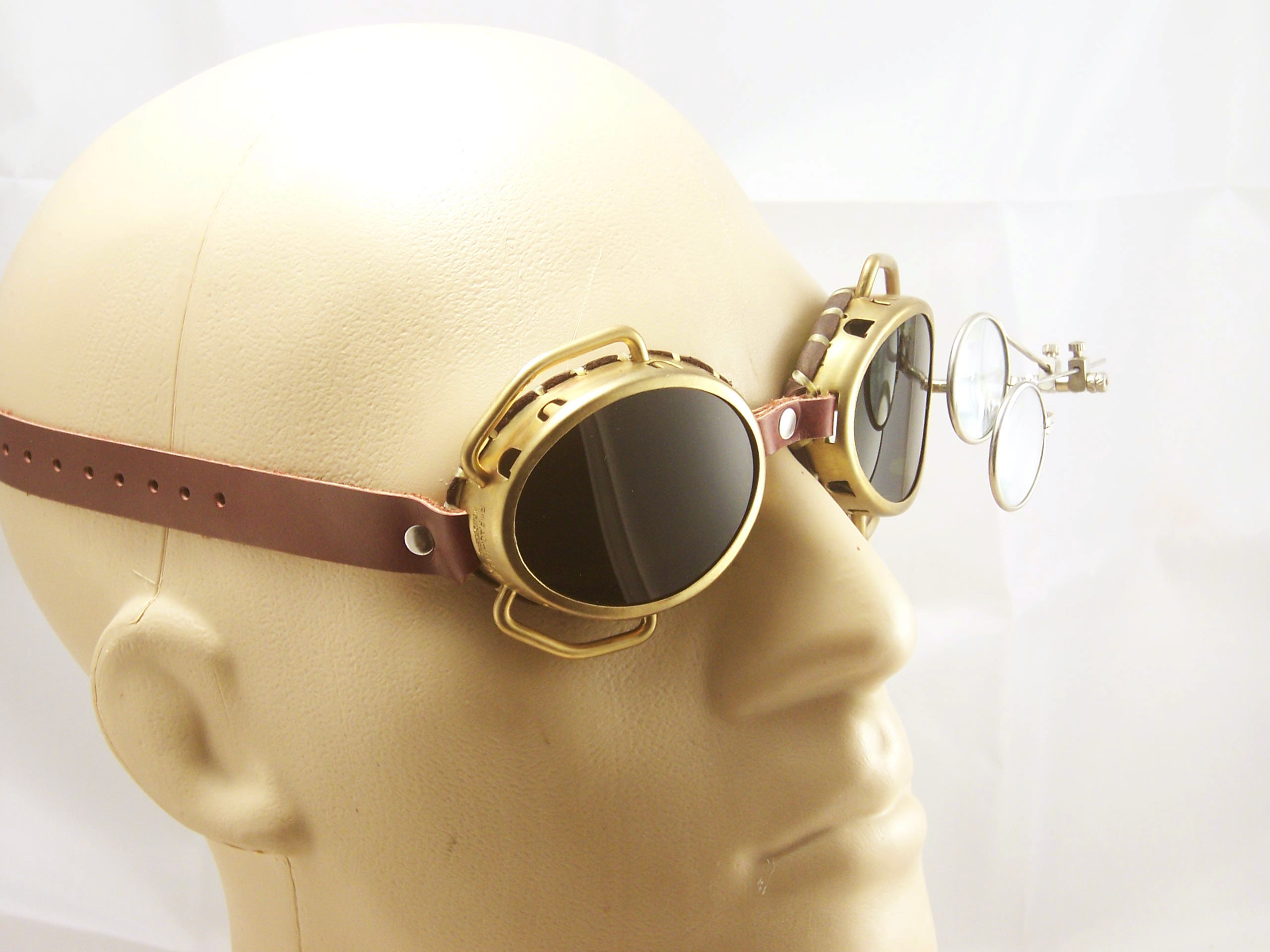rebelsmarket_steampunk_goggles_solid_brass_with_flip_down_magnifiers_and_conduits_goggles_3.jpg