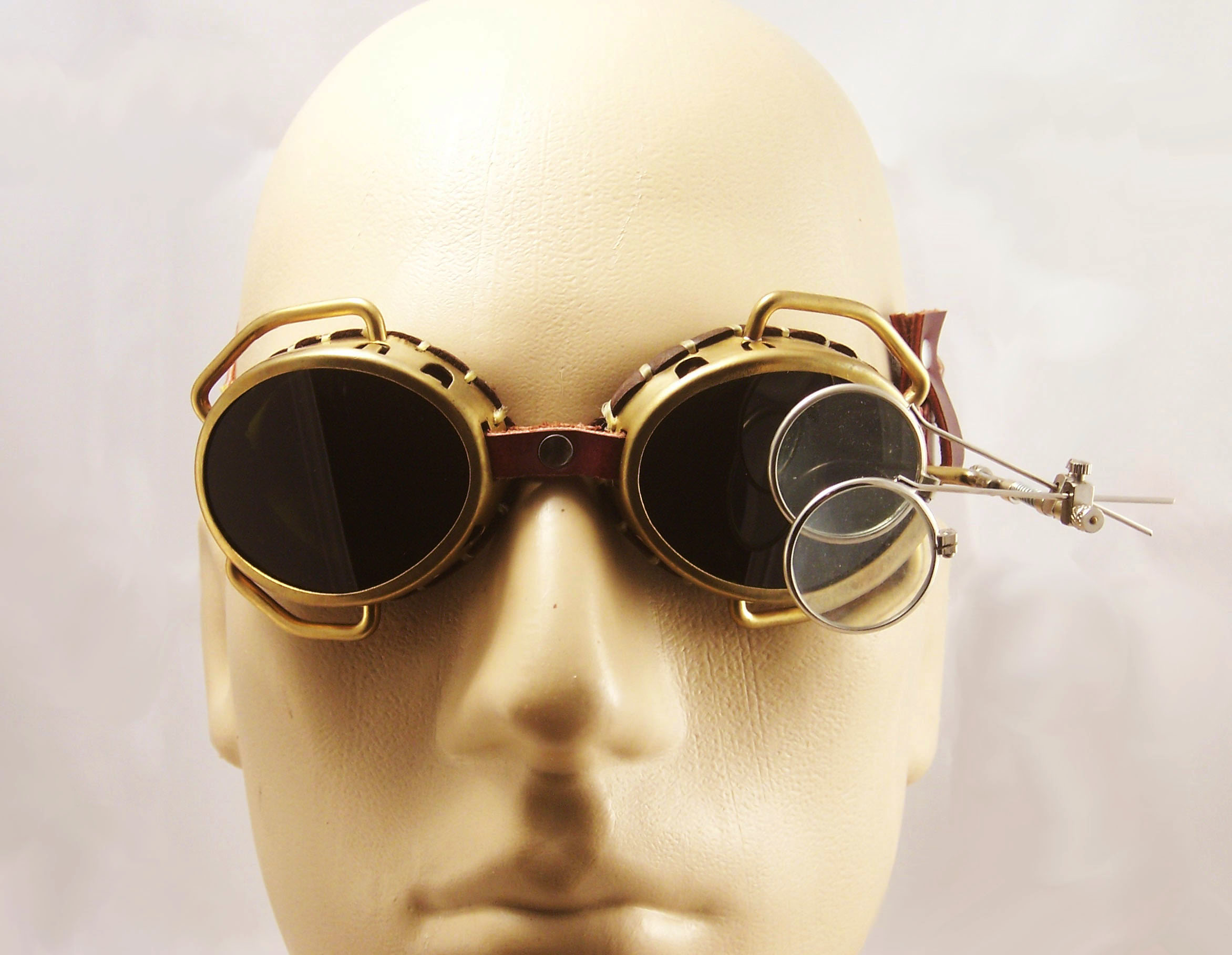 rebelsmarket_steampunk_goggles_solid_brass_with_flip_down_magnifiers_and_conduits_goggles_2.jpg