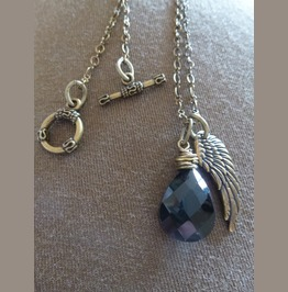 Antique Brass Wire Wrapped Black Crystal With Antique Brass Angle Wing