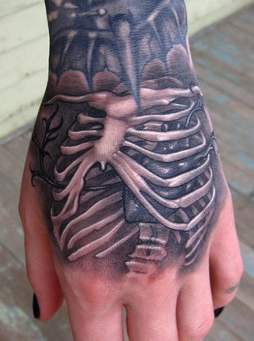 Skeletal Rib Cage hand tattoo