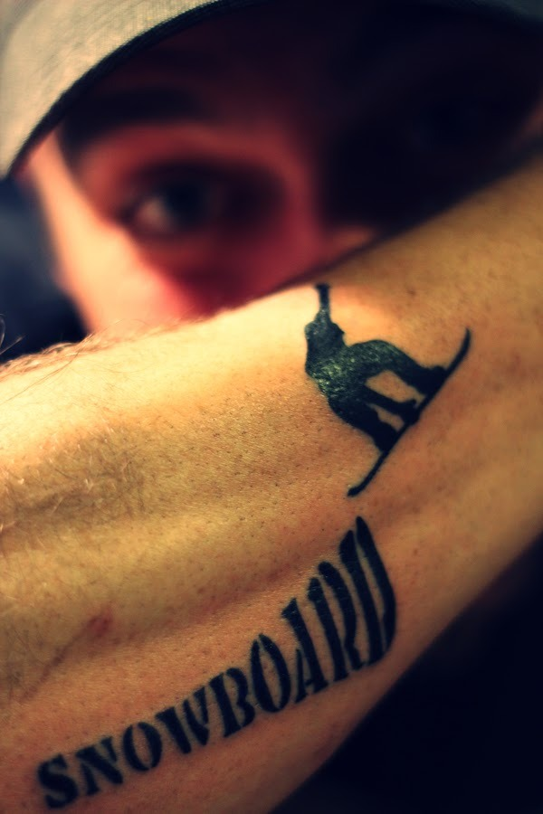 Similar yet Cool Tatoo Idea of snowboard jump - tattoo on arm