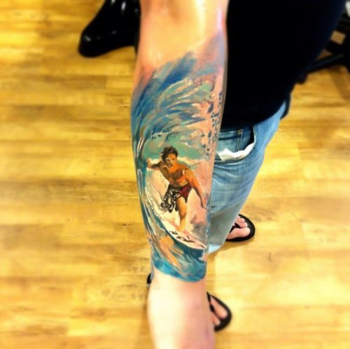 awesome stunning surfing surfer arm tattoo