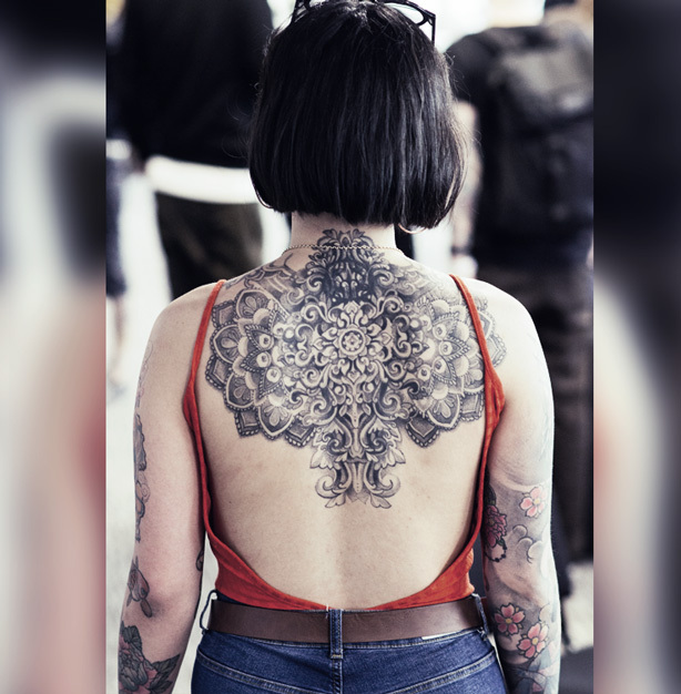 Short hair helps give a full view of your beautiful back tattoo.