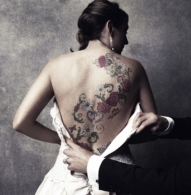 Be yourself on your wedding day! Opt for a gown that works with your back tattoos.
