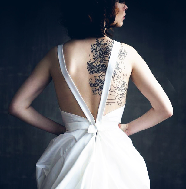 There is no reason to hide your back tattoo during your wedding.