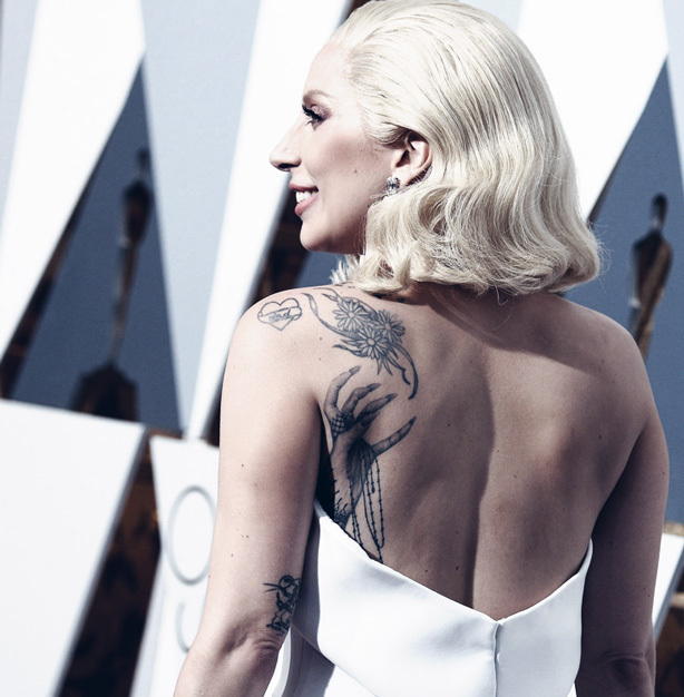 A plain white gown will allow your back tattoos to stand out at formal events.