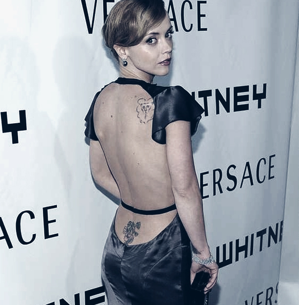 You do not have to cover your back tattoos for formal events.