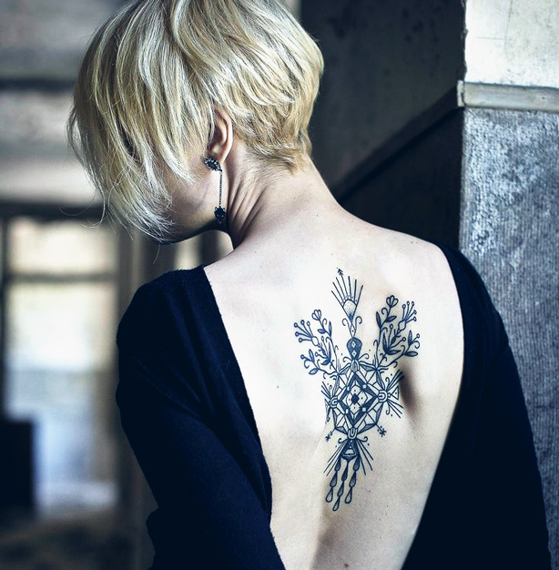Let your back tattoo become a statement accessory for formal affairs.