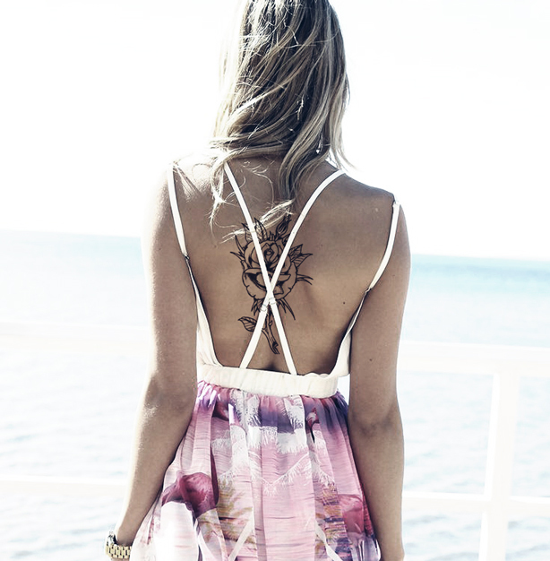 Show off a back tattoo with cute floral dresses.