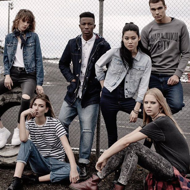 A picture of young men and women wearing urban fashion items, jeans and denim