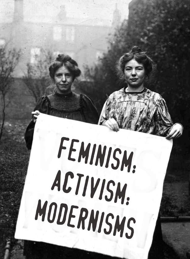 A black and white photograph of two women holding a board with the slogan Feminism: Activism: Modernisms