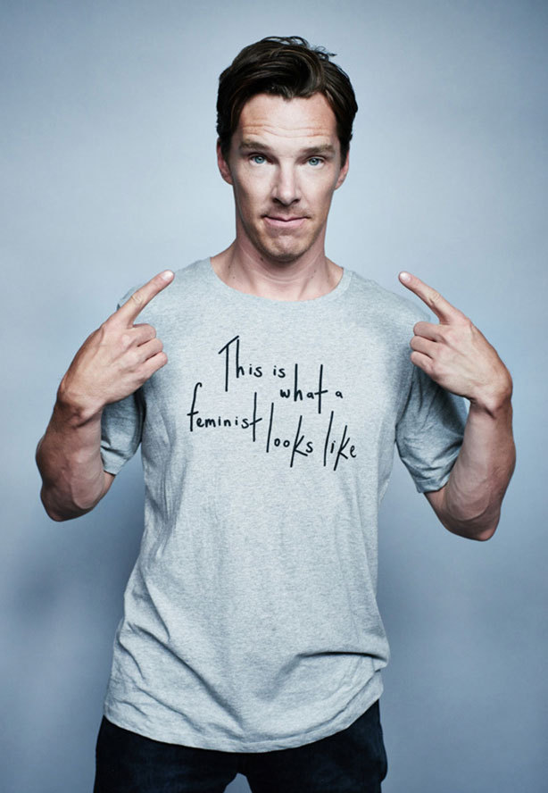 "Benedict Cumberbatch supports feminism by wearing a grey t-shirt with the phrast ""this is what a feminist looks like"" printed on the front"