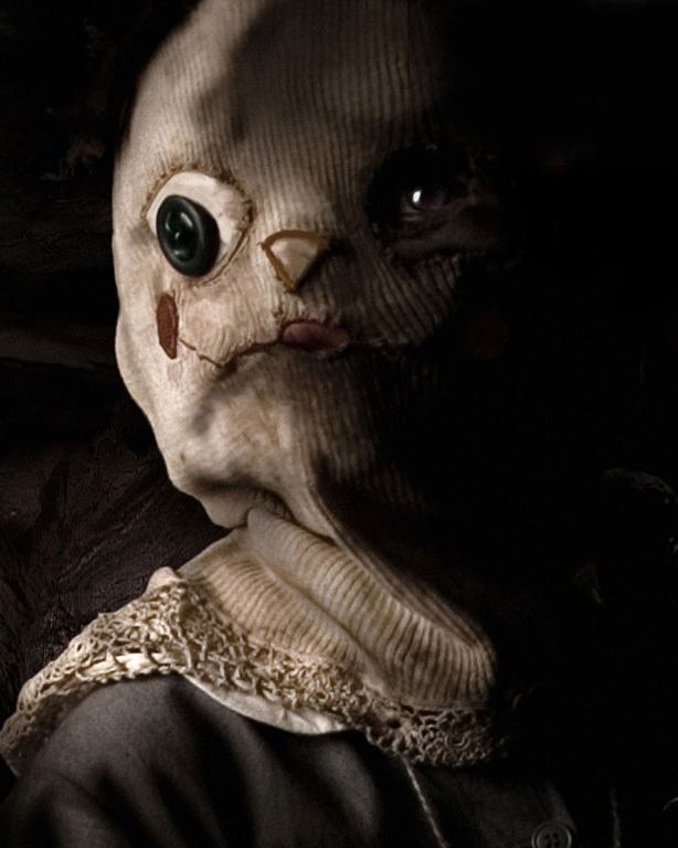 An image of the creepy mask from the horror movie The Orphanage