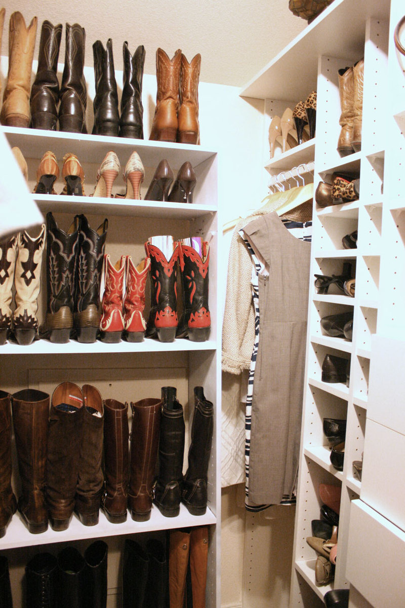 Image of a large collection of different boots, stored in a closet